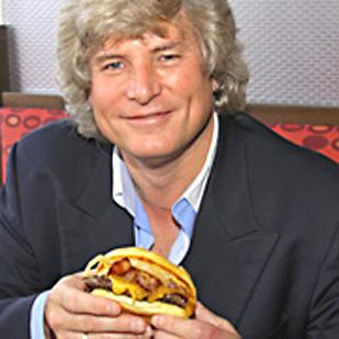 Tom Ryan, founder of Smashburger, is adding a sinfully decadent burger on the menu for a limited time.