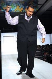 "Juan Ramirez won the $3,000 ""healthy hero"" award in the H-E-B Slimdown Showdown for losing 38 pounds."