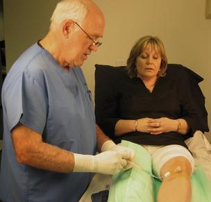 Dr. Larry Miller attends to a patient with the EZ-IO device.