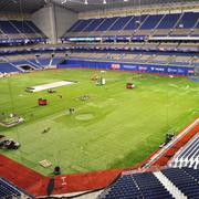 Alamodome personnel pushed back retractable sections of seating to make room for the temporary baseball field.