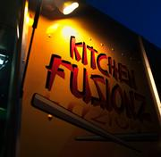 An outdoor photo of the Kitchen Fusionz food truck sign.