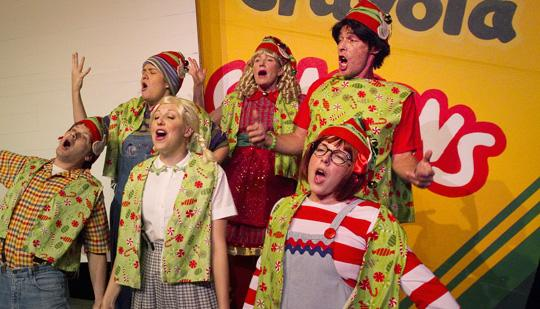 """The students of Room One sing out in """"Junie B. Jones in Jingle Bells, Batman Smells"""" at Magik Theatre. A recent Facebook fan won one of the jingle hats similar to those worn by the actors."""
