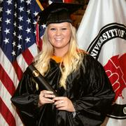 Staci Baney in her graduation photo from the University of the Incarnate Word.