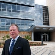Best Office Development:Kinetic Concepts Inc. Headquarters —Kinetic Concepts Inc.'s CEO Joe Woody stands in front of the company's new 100,000-square-foot headquarters building at 12930 Interstate 10, south of Hausman Road.