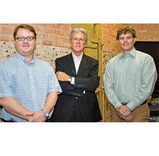 Jim Aderhold and Brad Gray of Gray Digital Group, with Steve Atkins (in the middle) of The Adkins Group.