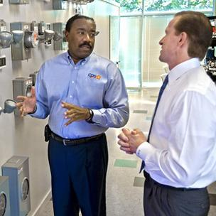 (L to R) CPS Energy CEO Doyle Beneby discusses smart-meter technology with Roy J. Moore, chief development officer of Consert Inc., which this year relocated to San Antonio.