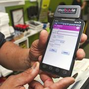 Los Jalapeños co-owner Pedro Cabrera, has his delivery employees uses Mobuyle to process off-site payments.