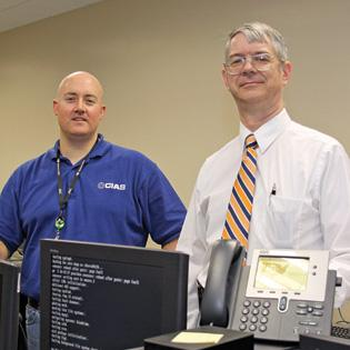 (L to R) Dwayne Williams and Gregory White will oversee the National Collegiate Cyber Defense Competition when it comes to San Antonio later this month.