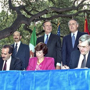 In October 1992, Mexican President Carlos Salinas, US President George Bush Sr., and Canadian Prime Minister Brian Mulroney looked on in San Antonio during the initialing of the NAFTA treaty. Photo courtesy of George Bush Presidential Library and Museum.
