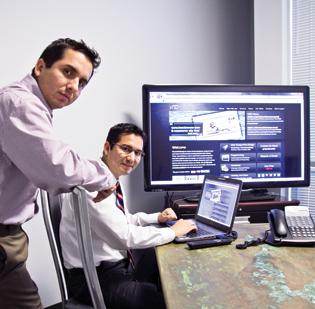 (L to R) Javier and Manuel Oblitas came to the United States in 1995 from Peru and have launched a successful IT business.
