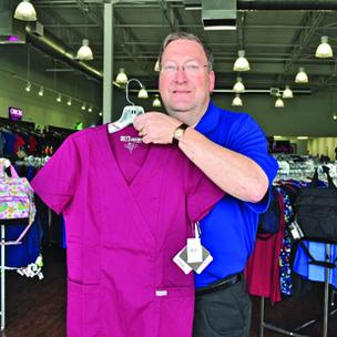 Classic Uniforms owner Barry Schklar says that adding a trendier decor and more color choices are designed to appeal to a newer generation of customers.