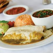 Paloma Blanca's chicken enchilada, served with sides of beans, rice and guacamole.