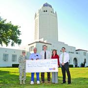 A CPS rebate check for $23,048 is presented to JBSA for its role in the Energy Demand Response Program this summer. L-R: Col. Christine Erlewine; Luis Medina; Bruce Dschuden; Yvonne Haecker; and Ruben Ramos.