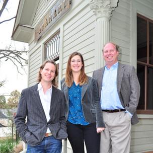 Left: Tobin Smith, Kristin Wiese and Clay Hefty — the principals in a new firm called Dado Group — stand outside The Granary 'Cue & Brew restaurant. Above: The Granary at night.
