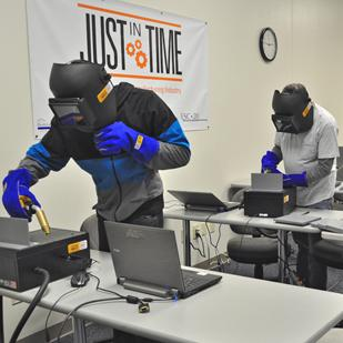 Students in the Just In Time program work with equipment they will be using on the job once they graduate in March.