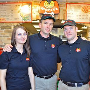 Dan Stakley (center), daughter Sam and son in law Michael Baker make Marco's Pizza a family business.