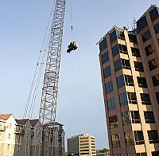 A 400-ton chiller is hoisted on top of Renaissance Plaza.