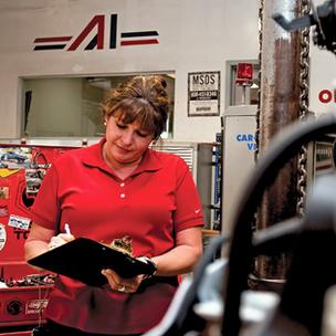 Kimberly Gray, a service advisor for Service King in San Antonio, is helping to make the auto repair experience more amenable to female customers.