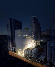 An aerial view of the SFMOMA expansion by night, taken from Howard Street