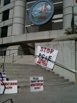 Smart meter detractors are now focused on what if any health risks smart meters pose to the public. Shown here, protestors' signs on the steps of the California Public Utilities Commission.