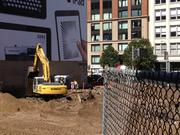 A backhoe moving dirt at 222 Second St.