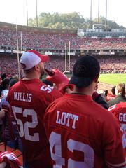 49ers fans enjoy a beer at a playoff game against the Saints.