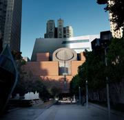 A view from Yerba Buena Garden of the original Mario Botta-designed SFMOMA entrance with the Snøhetta expansion rising above and behind it.