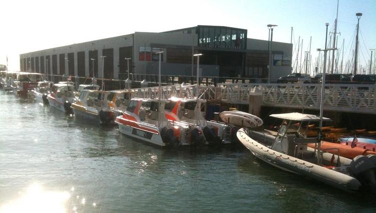 More than a dozen high-speed chase boats and other craft lined up at Pier 40 in preparation for America's Cup racing in San Francisco on Aug. 10.