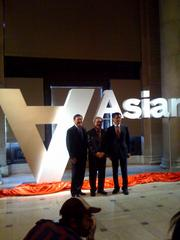 A 3-D rendition of the new Asian Art Museum logo. Standing in front of it are (r-l) Anthony Sun, chair of the museum board of trustees, San Francisco Mayor Ed Lee and Museum Director Jay Xu.