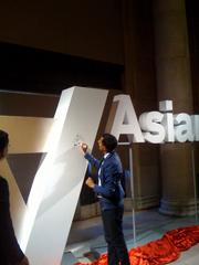 Artists Sanjay Patel doodles a maharaja's head on the inverted A as part of the unveiling of the Asian Art Museum's rebrand.
