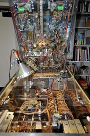 A ping pong machine being fixed in the laboratory. With exhibits like this, the museum is attempting to highlight the intersection between science and art.