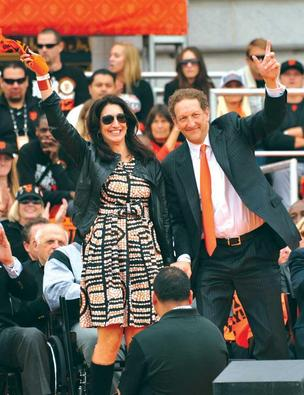 Giants CEO Larry Baer with wife Pam during 2012 World Series victory parade.