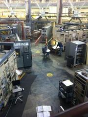 Men working on the floor of the Advanced Light Source at Berkeley Lab.