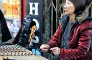 Local street musicians bring culture and life to Chinatown. But on this particular day, which has been typical of the summer, there weren't many people around to play for.