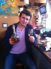 Juan Carlos Contreras, son of Don Pilar, displays the company's anejo variety at Tres restaurant in San Francisco.