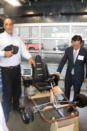 Autodesk CEO Carl Bass shows off an electric go-kart his son is making.