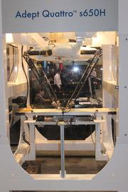 This may look like a surgical operating table from a space ship, but it's actually an Adept Quattro, a four-armed machine that is the only one of its kind accepted by the U.S. Department of Agriculture for meat and poultry processing. Adept is based in Pleasanton. Founded in 1983, Adept is based in Pleasanton.