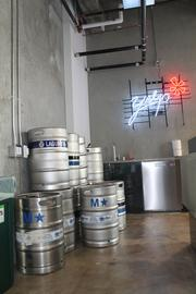 A bank of kegs stockpiled for an upcoming hackathon.