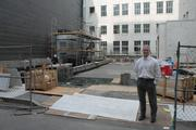 Seth Bland, partner at landlord Wilson Meany, stands before an outdoor courtyard and sculpture garden that is still under construction.