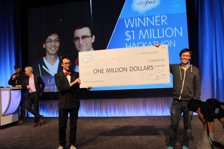 Joseph Turian and Thom Kim hold aloft their ceremonial million dollar check with Salesforce CEO Marc Benioff (far left) and CTO Parker Harris in the background.