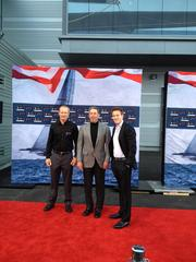 Oracle CEO Larry Ellison (center) with Oracle Team USA Skipper James Spithill (left) and his son, movie producer David Ellison (right).