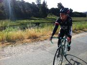 A cyclist roles into the Mill Valley Energizer Station.