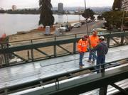 Workers checking the connected sections of one half of the bridge Sept. 18.