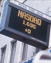 California Street, Sept. 11, 11:43 a.m.: A marquee gives the day's Nasdaq trading volume, 2:43 p.m. Wall Street time.