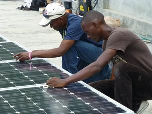 Workers in Haiti install solar at a local hospital.