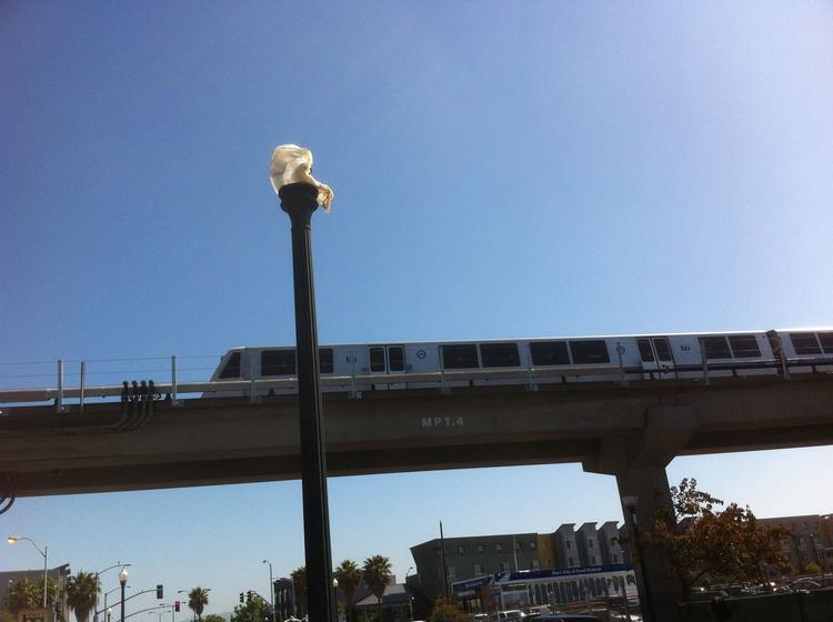 A BART train rolled past a melted street lamp at the West Oakland station Friday morning.