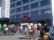 Protesters and spectators moved toward a Wells Fargo branch in downtown Oakland on Wednesday.