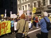 Protesters march to shut down a bank in Oakland.