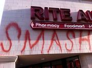 The Rite Aid pharmacy at the corner of 14th and Broadway, which closed Wednesday to support the strike, was nevertheless covered in painted slogans and slurs.