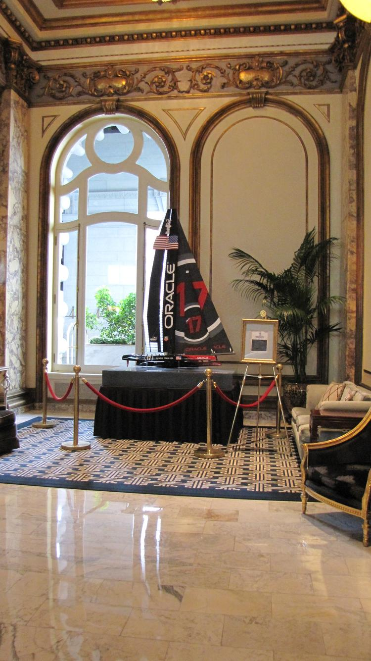 A six-foot replica of the Oracle boat displayed in the lobby of the Fairmont Hotel.